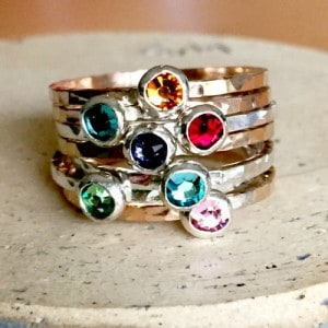 Add a bit of bling to your fingers with a delicate stackable birthstone ring!
