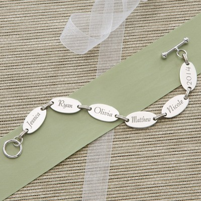 Simple but meaningful, this sweet mother's day bracelet features 6 discs engraved with the names of her loved ones.