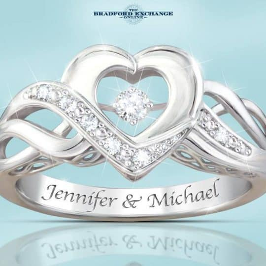 Gorgeous heart-shaped ring features a special setting that allows the center diamond to move freely. A beautiful expression of your love!