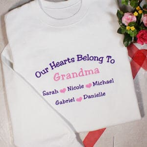 This beautifully embroidered sweatshirt creates a unique way to display the love you have for your grandchildren. Available in white