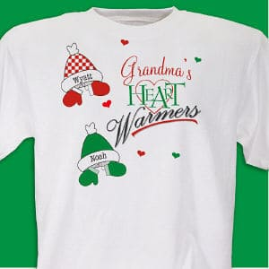 Grandma's heart will be overfilled with warmth and joy each time she wears this personalized Christmas t-shirt. Our custom Heart Warmers shirt can be personalized with any title and decorated with up to 30 hat and mitten combinations