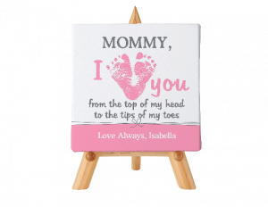 A sweet First Mother's Day gift from baby! Adorable baby footprints form a heart in the middle of the sweet saying. Personalize with any title at the top and a loving message at the bottom.