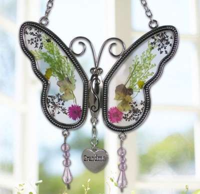 "How cute is this Grandma butterfly suncatcher? Love the real pressed flowers - and the adorable ""Grandma"" heart charm!"