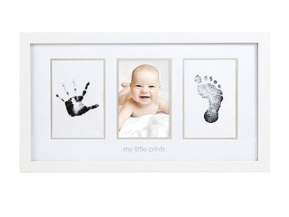 Adorable hand and footprint picture frame is a sweet Mother's Day gift idea for the new mom!