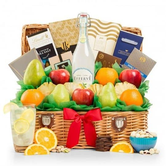 Fruit Gift Basket - Charming gift basket overflows with fresh-picked fruits, gourmet candies and sweet cookies.