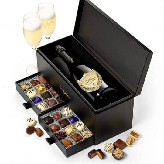 Champagne gift baskets - Impress someone special with this striking champagne and chocolate gift basket. Unique champagne gift box features 2 compartments that slide open to reveal a collection of gourmet chocolates.