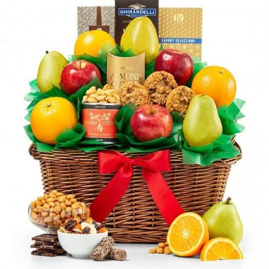 Gourmet Fruit Basket - Treat someone to a delightful fruit basket chock full of gourmet fruits, cookies, nuts, chocolates and more...an affordable gift basket the whole family will love!