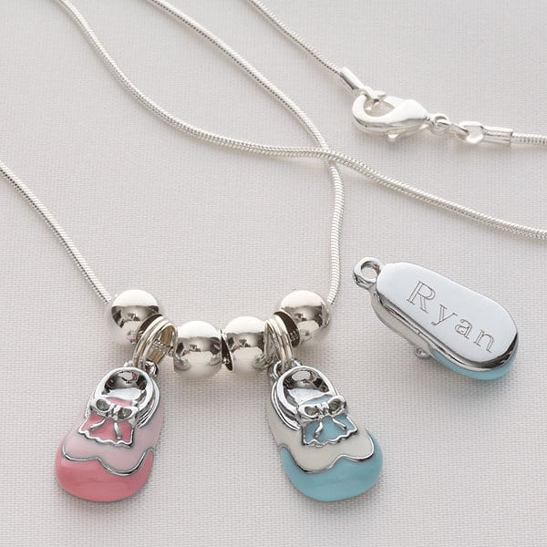 Pesonalized Baby Shoe Charm Necklace - Thrill Grandma with this adorable personalized baby shoe charm necklace!  Each grandchild's name is engraved on a pink or blue baby bootie.  Perfect Mother's Day, Christmas or birthday gift for grandma.