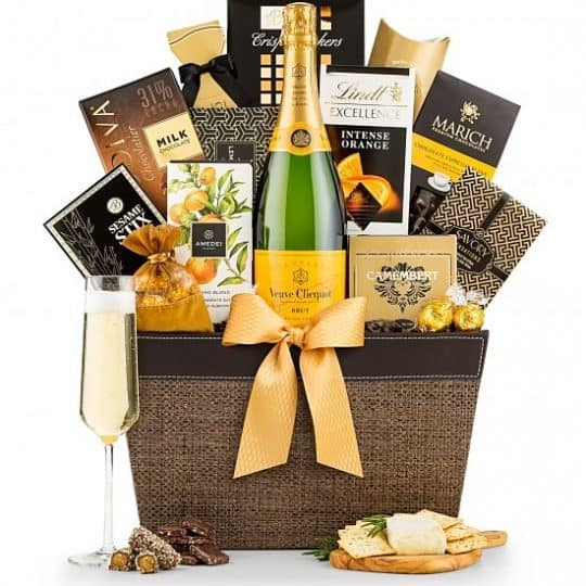 Champagne gift basket - Looking for an elegant gift basket to celebrate a momentous occasion? Impress them with this opulent champagne gift basket featuring luxury sweets and a bottle of world-class Veuve Clicquot Brut champagne!